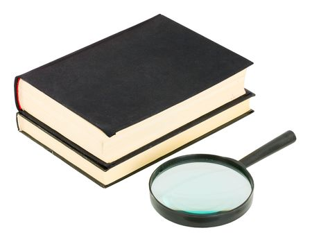 Books and magnifying glass on the white background photo