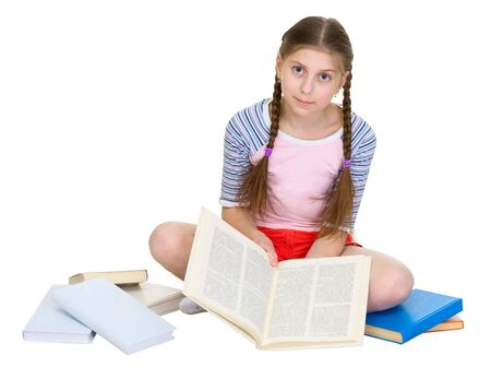 blinders: Schoolgirl sitting with a heap of books on a white background