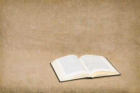 The opened book on canvas background Stock Photo