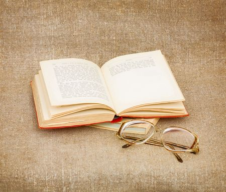 Still-life from eyeglasses and the old book