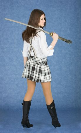 jackboot: Beautiful girl in a skirt with the Japanese sword on blue background