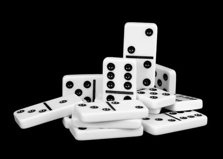 wavering: Small group of bones dominoes on a black background Stock Photo