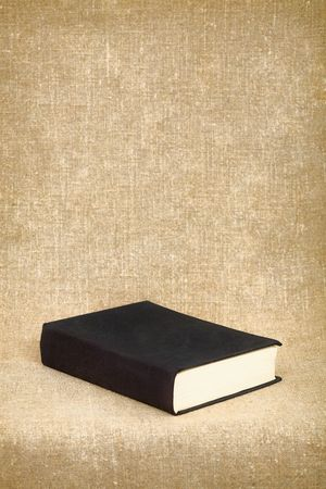 The black book on the fabric background Stock Photo