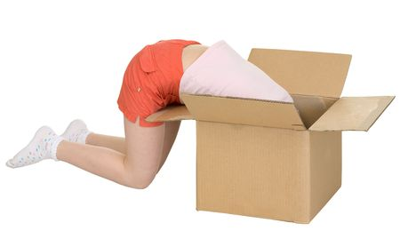 blinders: Young girl climb in cardboard box on the white Stock Photo