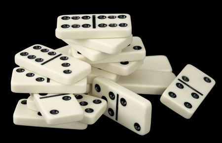 wavering: Heap of domino bones on the black background Stock Photo