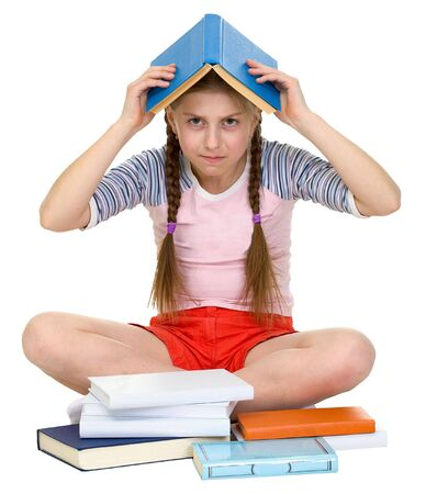 blinders: Young girl with book on head on the white Stock Photo