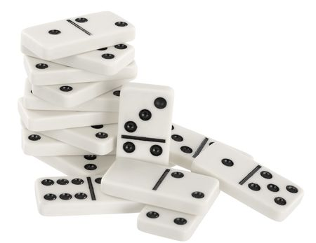 wavering: Heap of bones of dominoes on a white background