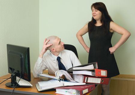 The boss and the secretary on a workplace at office photo