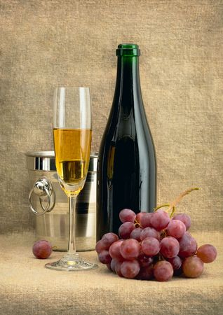 Beautiful still-life with champagne wine and grapes Stock Photo - 5031145