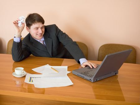 Businessman on a workplace with the laptop and a coffee cup Stock Photo - 5044821