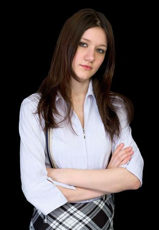 unsmiling: Portrait of the serious beautiful girl on a black background