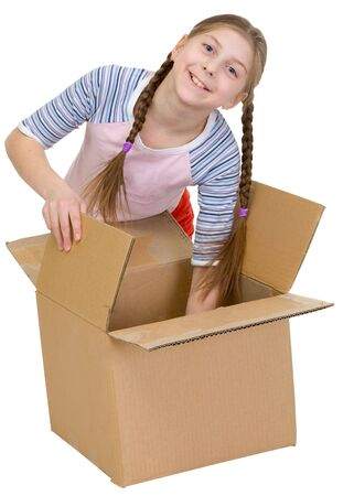 thrust: Girl thrust the hand into cardboard box on white