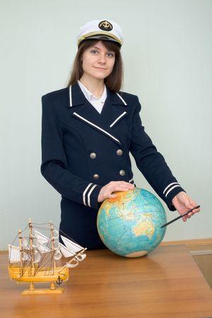 sailer: Girl in a sea uniform with the globe