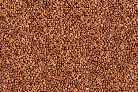 The dark fried coffee beans color background photo