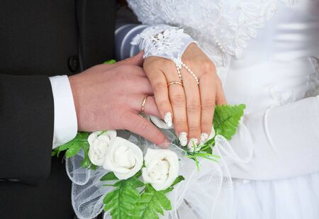 The male and female hands with wedding rings photo