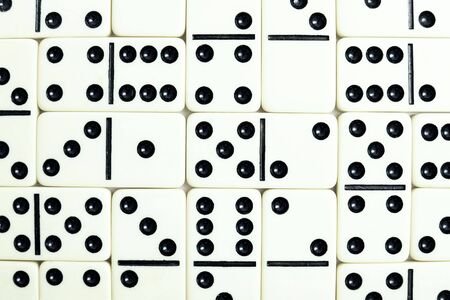 regimented: Wall from grey bones of dominoes background Stock Photo