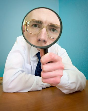 magnifier glass: Funny people with a magnifier in a hand