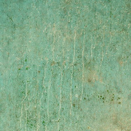 peeling paint: The ancient grunge cracked wall with dirt smudges Stock Photo