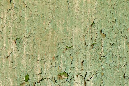 Old damaged paint on a concrete wall texture photo