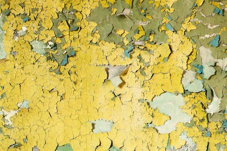 Old damaged paint on a concrete wall background photo