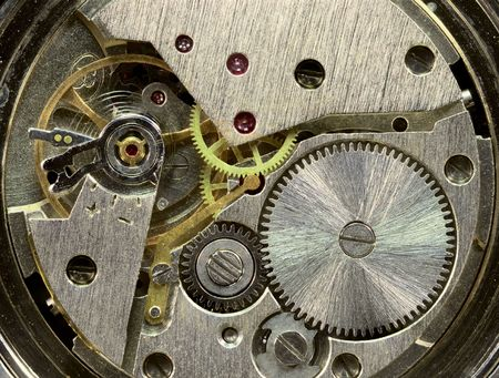 Macrophoto of a tiny old clockwork background photo