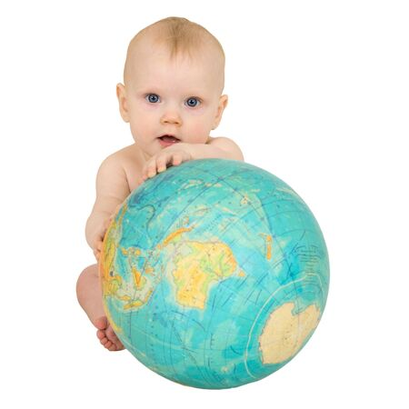 Baby with the geographical globe isolated on a white background photo