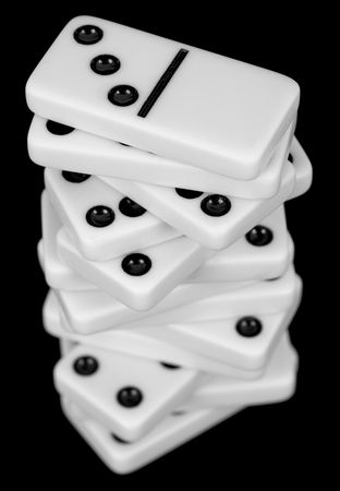 wavering: Pile from dominoes isolated on a black background Stock Photo