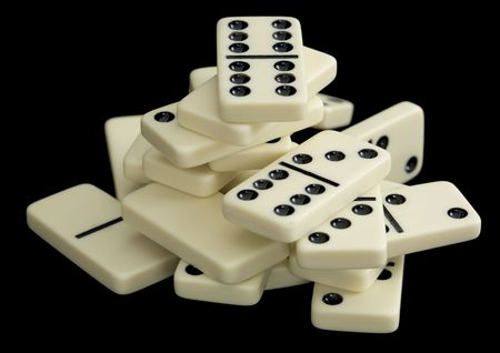wavering: Small heap of white dominoes on a black background Stock Photo