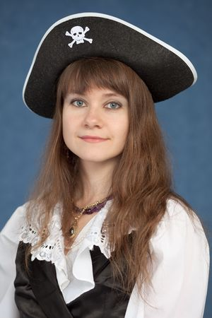 Portrait of pirate girl in black hat on a blue background photo