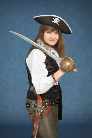 Pirate girl with sword on blue background photo