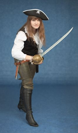 Pirate girl with sword rush to the attack on blue background photo