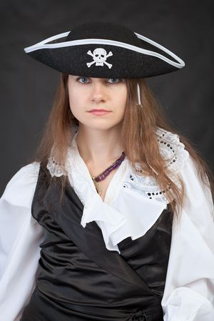 Portrait of serious pirate woman in black hat photo