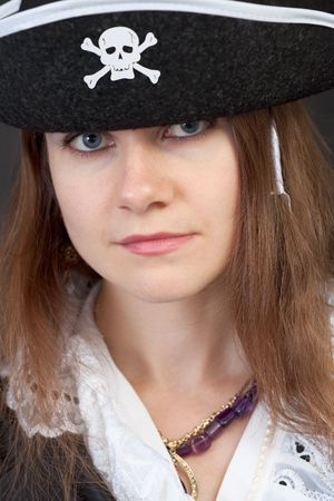 Portrait of serious pirate woman in black hat close-up photo