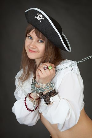 The young sexy girl in a costume of the pirate chained in a chain photo