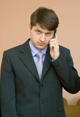 deliberation: The man speaks by a mobile phone