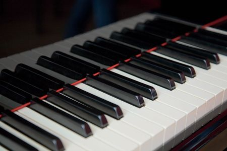 The classical grand piano keyboard close up Stock Photo - 5534370
