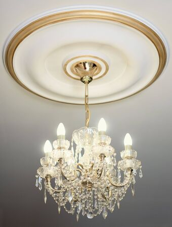 The big beautiful electric chandelier hanging down from a ceiling photo