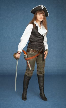 Pirate girl with sabre and pistol on blue background photo