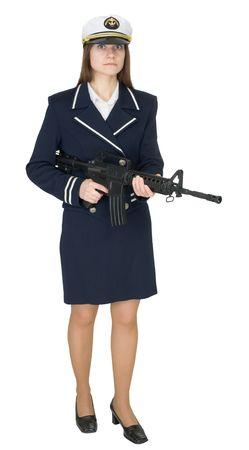 rifleman: La muchacha en un uniforme de la gente de mar con un fusil en las manos aisladas en fondo blanco Foto de archivo