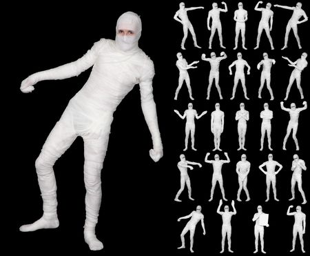Collection of the terrible bandaged mummies isolated on a black background photo