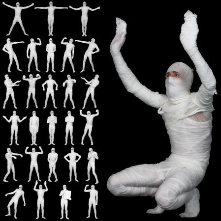 Collection of the bandaged mummies isolated on a black background photo