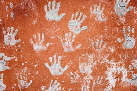 Concrete red wall decorated with amusing prints of hands photo