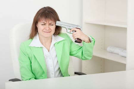 The young woman commits suicide on a workplace at office Stock Photo - 5746250