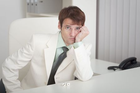 misses: The young businessman misses on a workplace at office Stock Photo