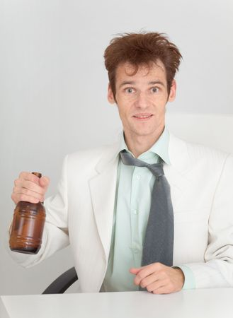 necktie beer: The young man at office with a beer bottle