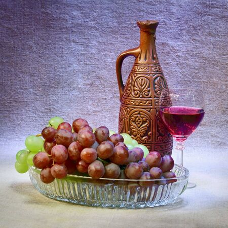 Still-life with a clay bottle, grapes and a glass Stock Photo - 5846603