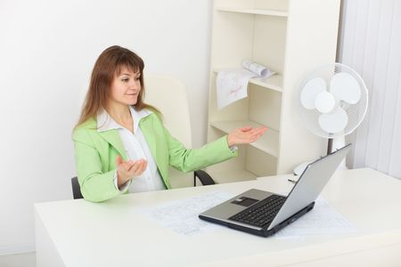 The woman sarcastically looks at the laptop screen Stock Photo - 5966037