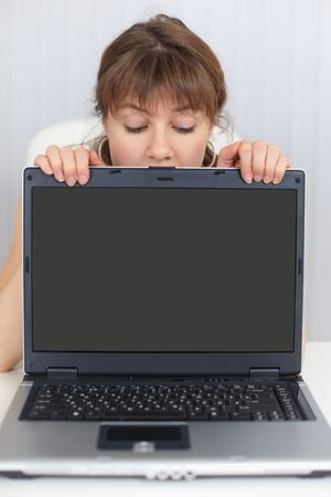 The woman and the blank screen of the laptop photo