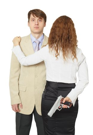 The man and the woman armed by a pistol it is isolated on a white background photo