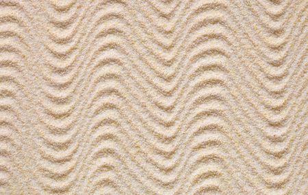 Texture de sable jaune recouverts de vagues
